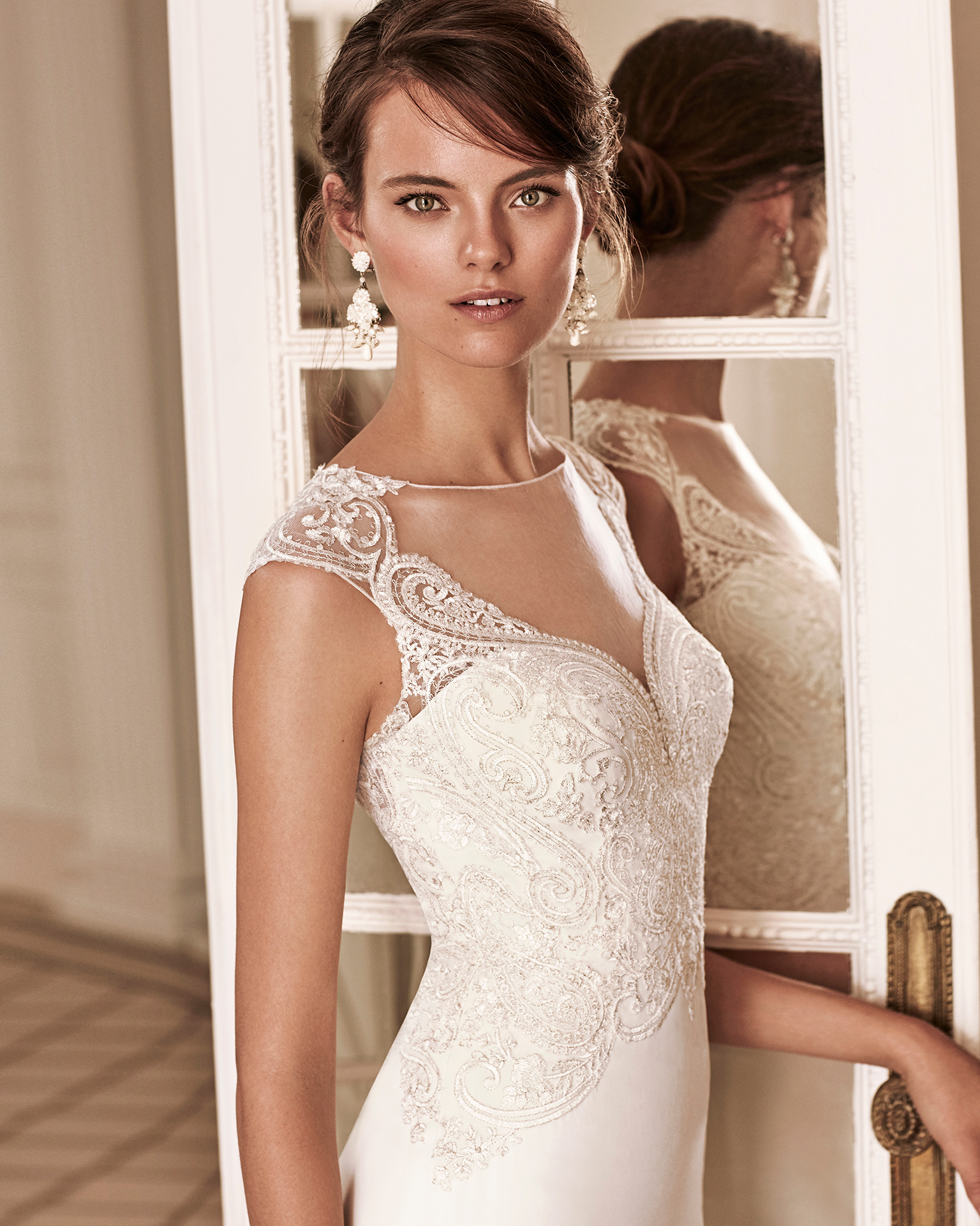 Mermaid-style crepe Georgette and lace wedding dress with deep-plunge neckline and low back.