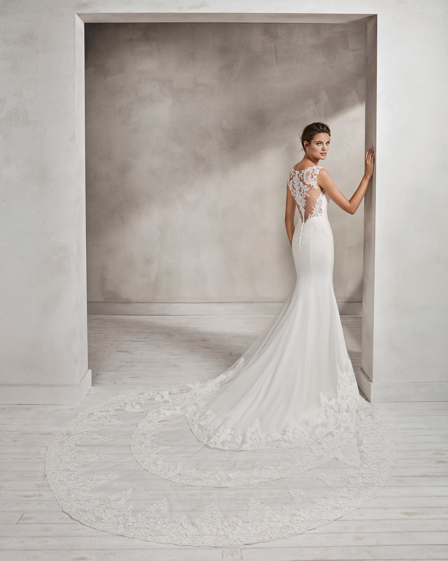 Mermaid-style crepe and lace wedding dress with sweetheart neckline and lace back.