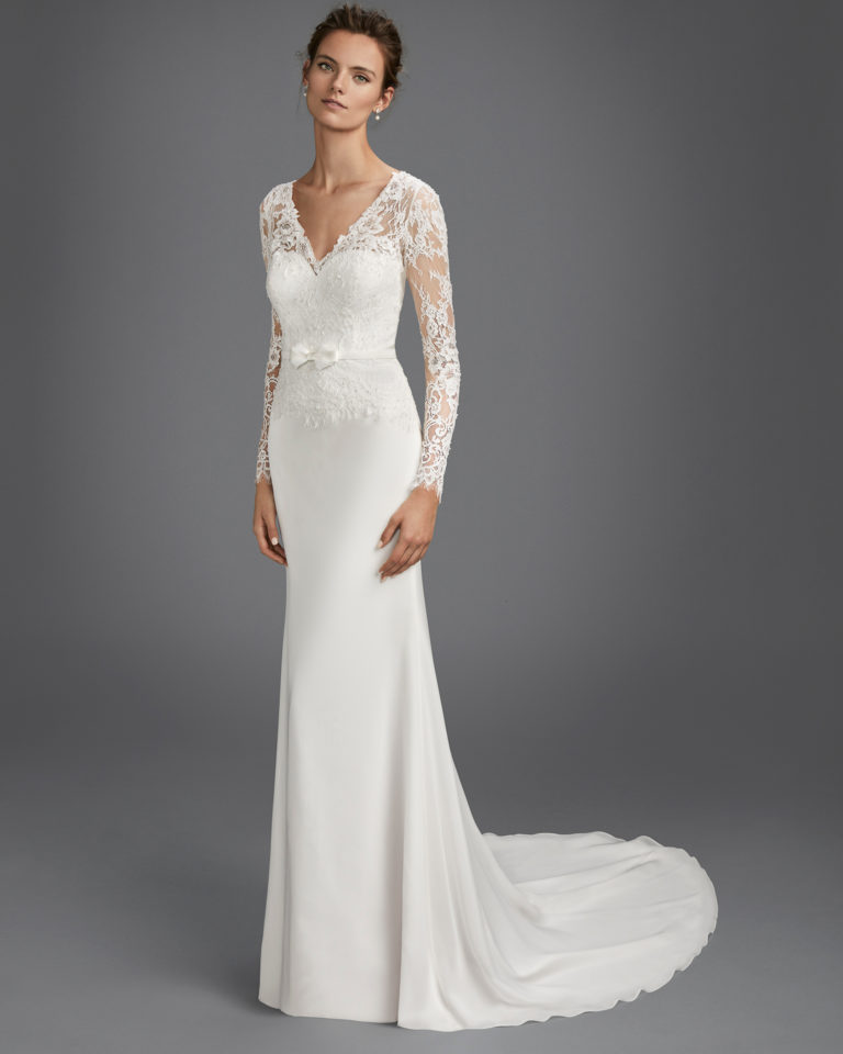 Mermaid-style beaded lace and chiffon wedding dress with long sleeves and V-back.