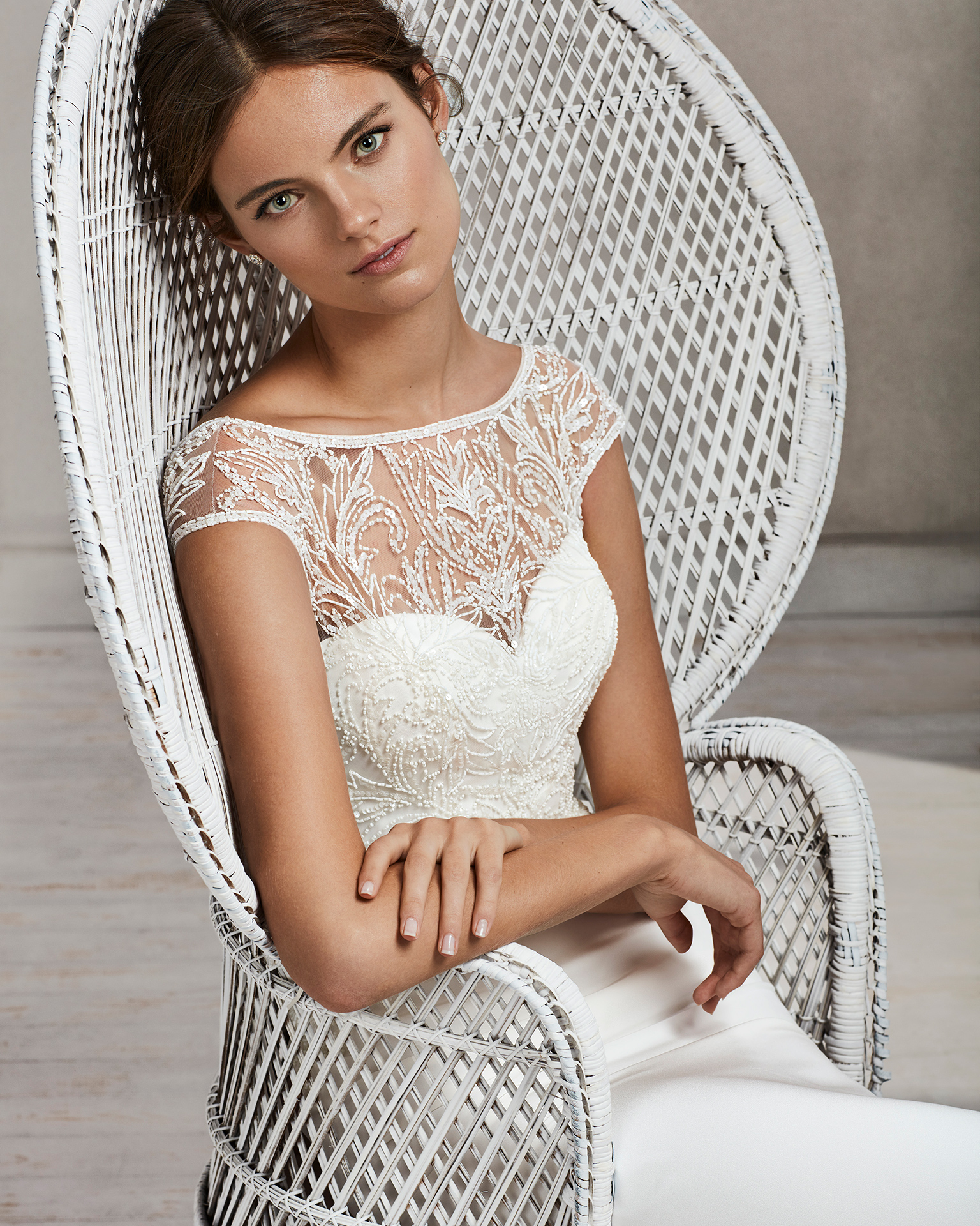 Mermaid-style beaded crepe wedding dress with illusion neckline and V-back.