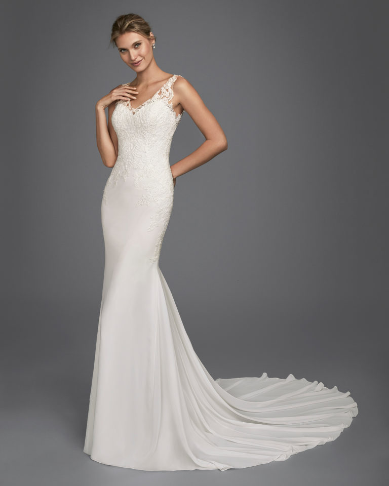 Mermaid-style beaded lace and chiffon wedding dress with tattoo-effect back.
