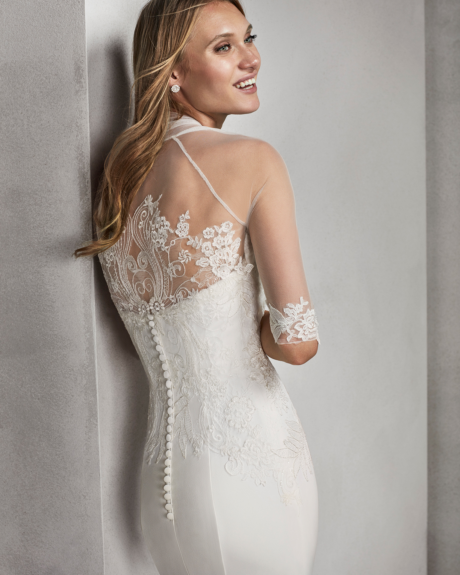 Mermaid-style beaded lace and crepe strapless wedding dress.