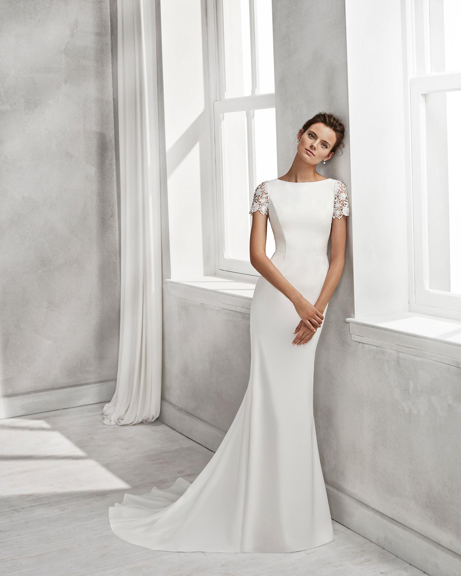 Vestidos de novia con manga corte sirena