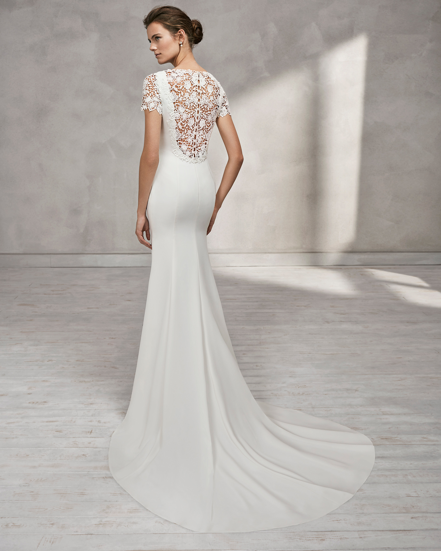 Mermaid-style crepe wedding dress with short sleeves, bateau neckline and guipure lace back.