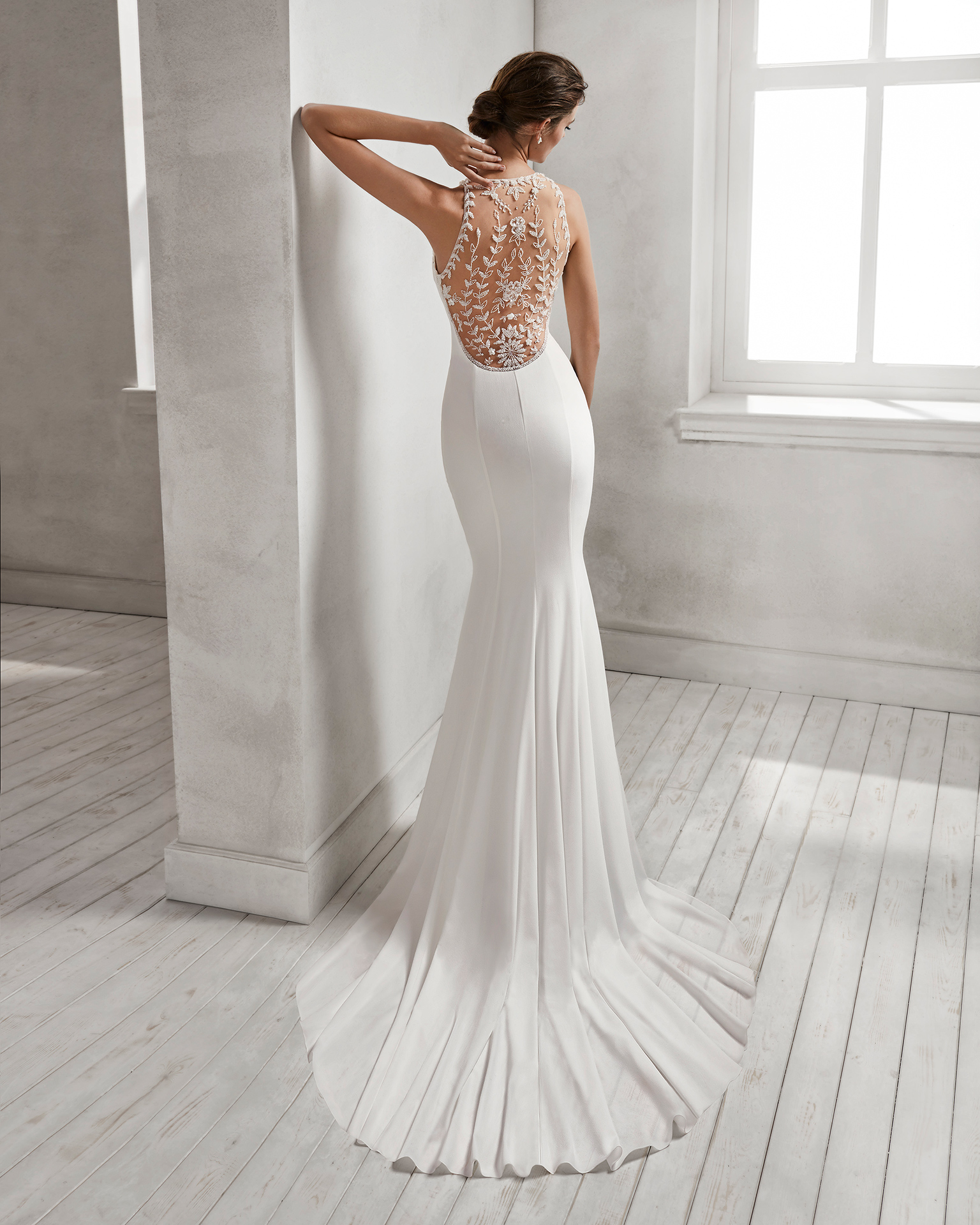Mermaid-style crepe Georgette wedding dress with halter neckline and beaded back.