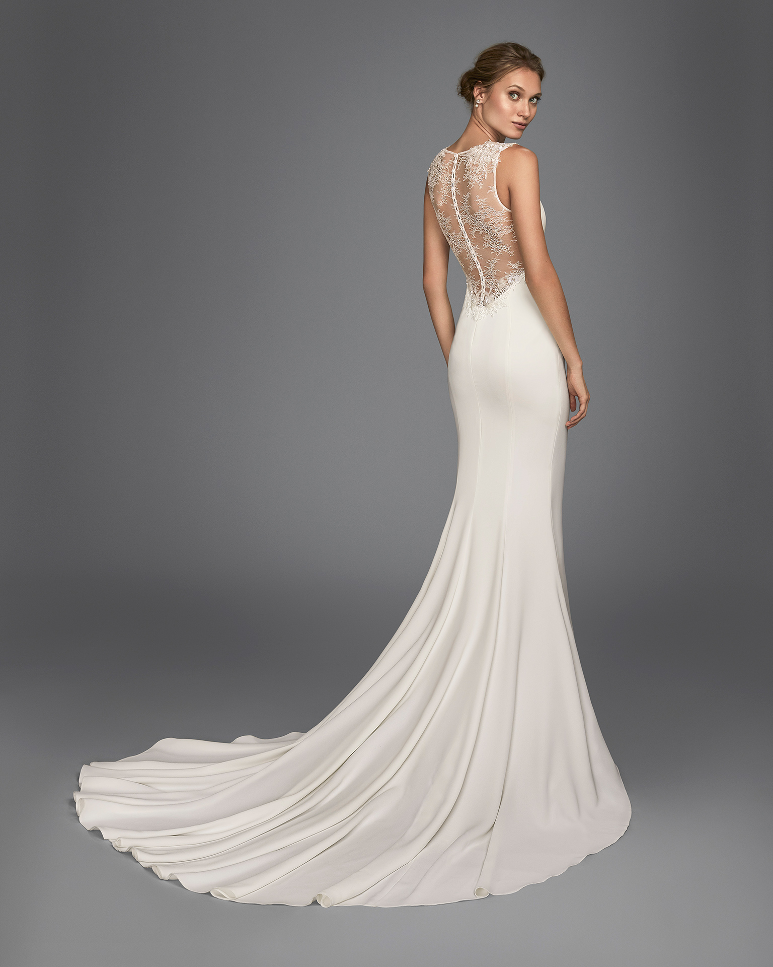 Mermaid-style crepe wedding dress with beaded lace back.