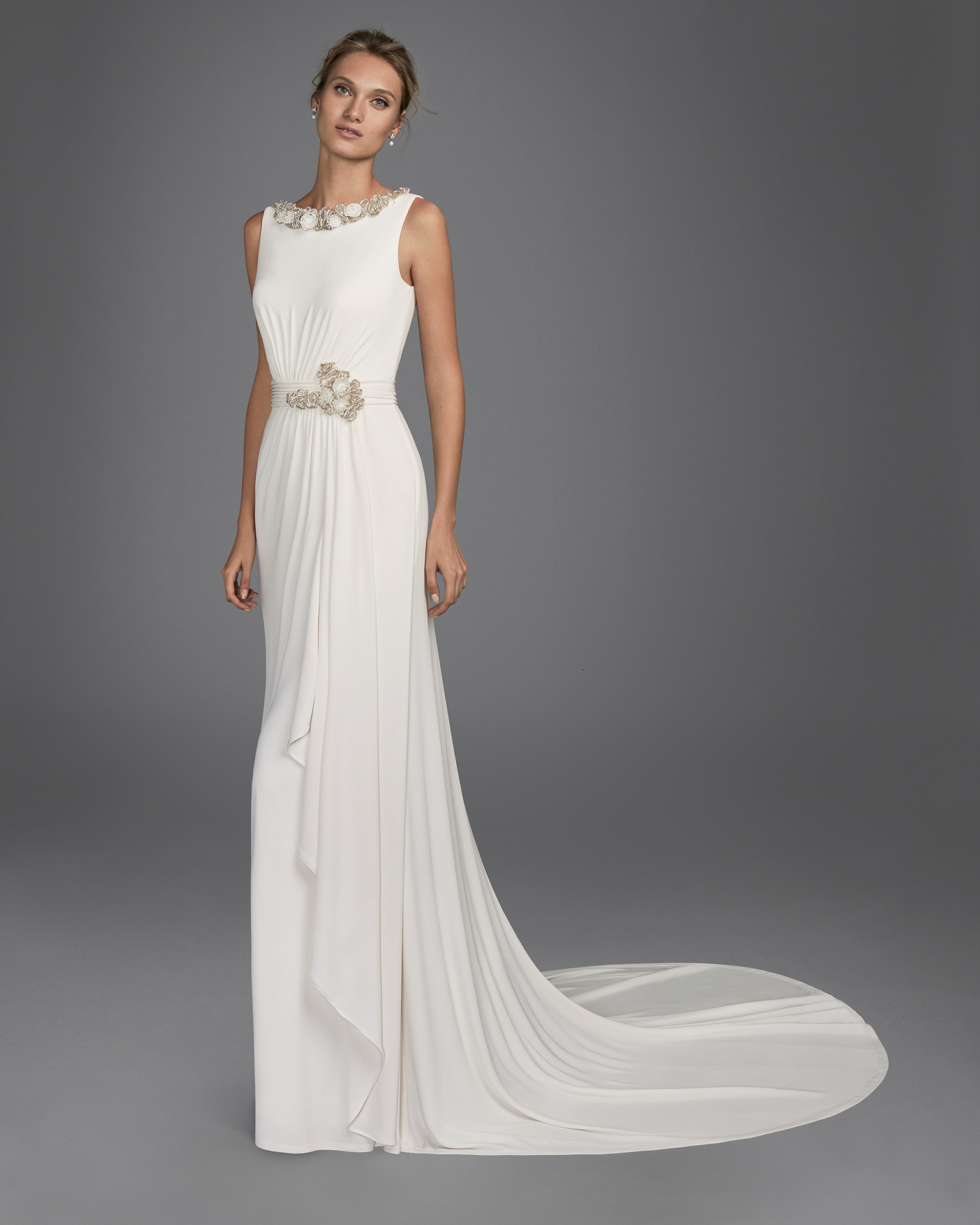Mermaid-style stretch crepe wedding dress with low back and beadwork appliqués.