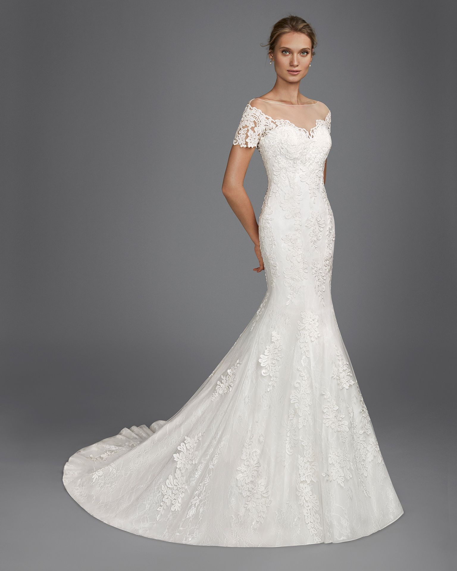 Mermaid-style lace wedding dress with off-the-shoulder neckline.