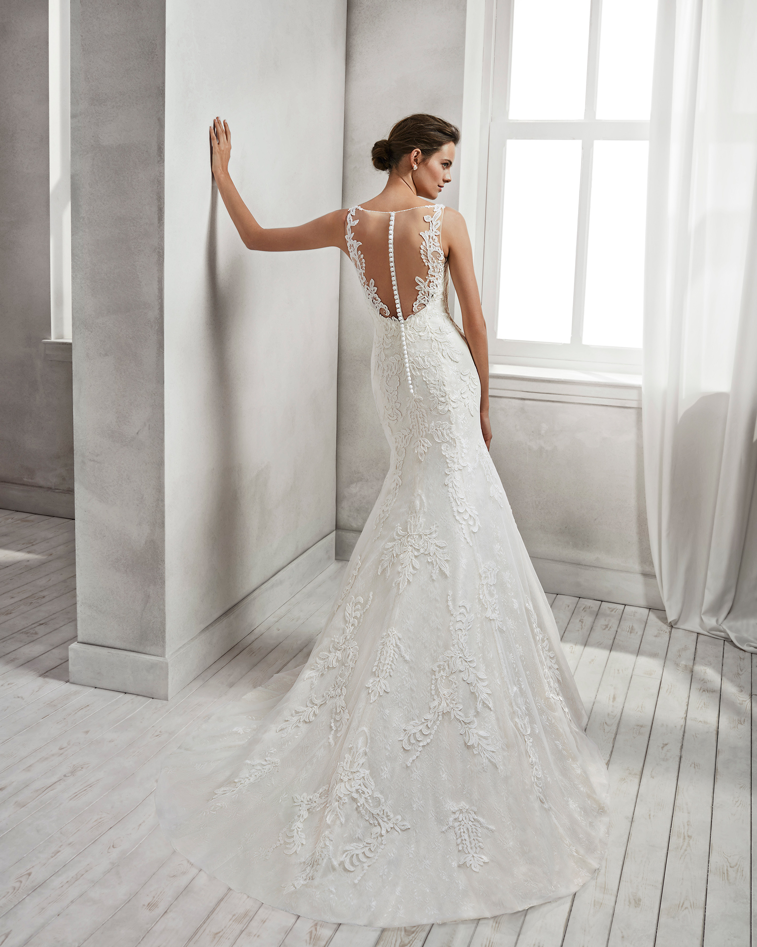 Mermaid-style beaded lace wedding dress with low back, in ivory and natural.