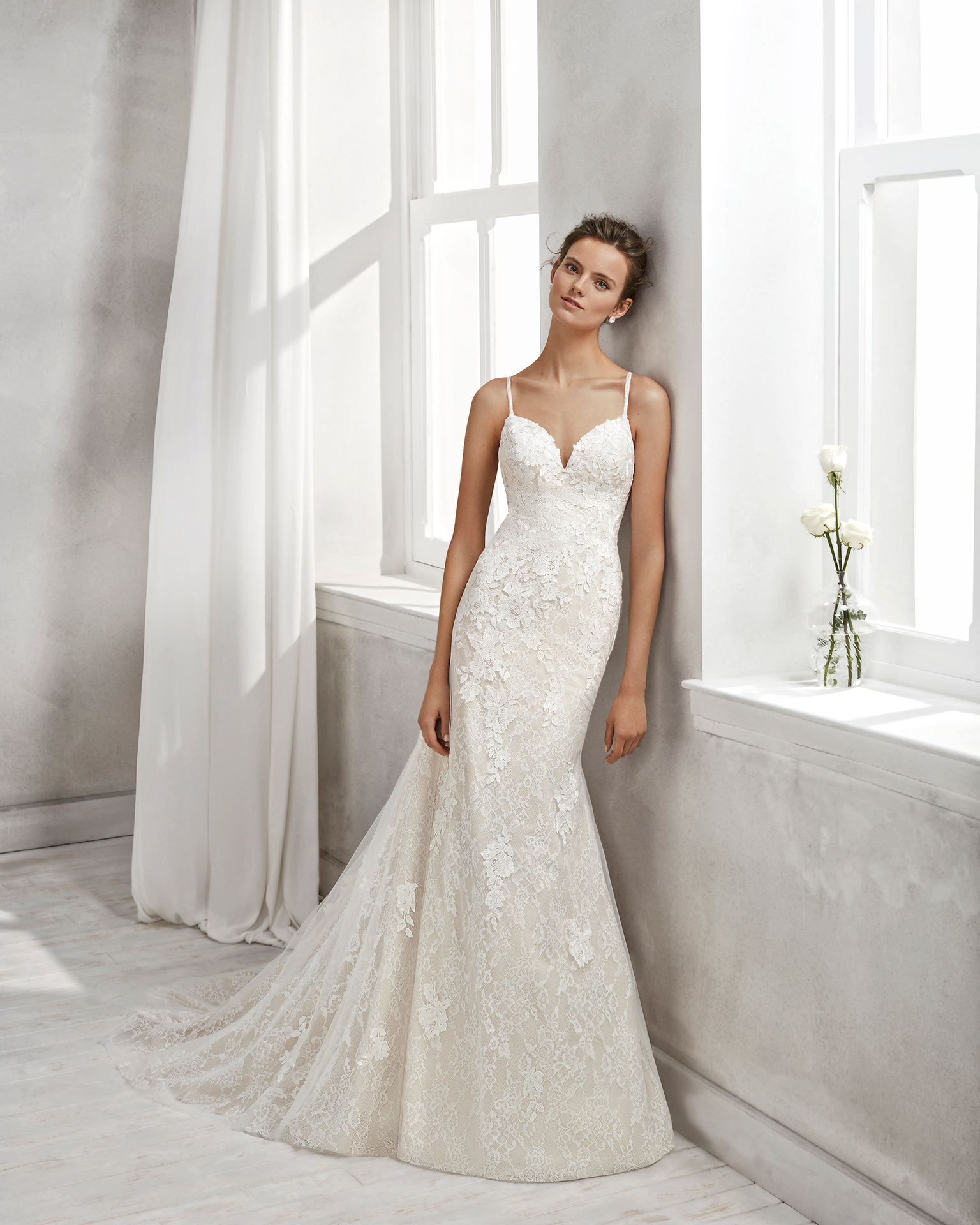 Mermaid-style beaded lace wedding dress with sweetheart neckline and tattoo-effect back, in nude and natural.