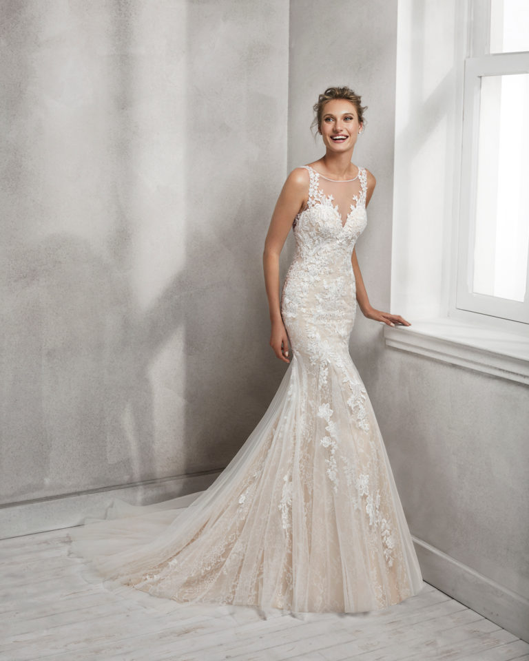 Mermaid-style lace wedding dress with illusion neckline and low back, in nude and natural.