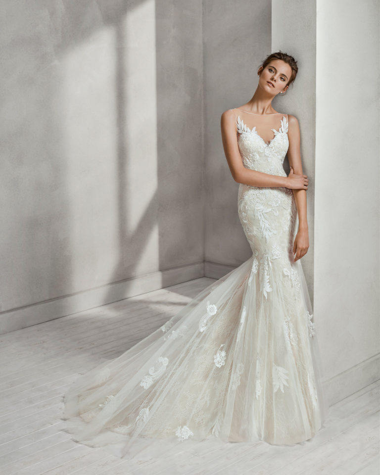Mermaid-style beaded lace and tulle wedding dress with V-neckline and low back, in nude, and in natural with overskirt.