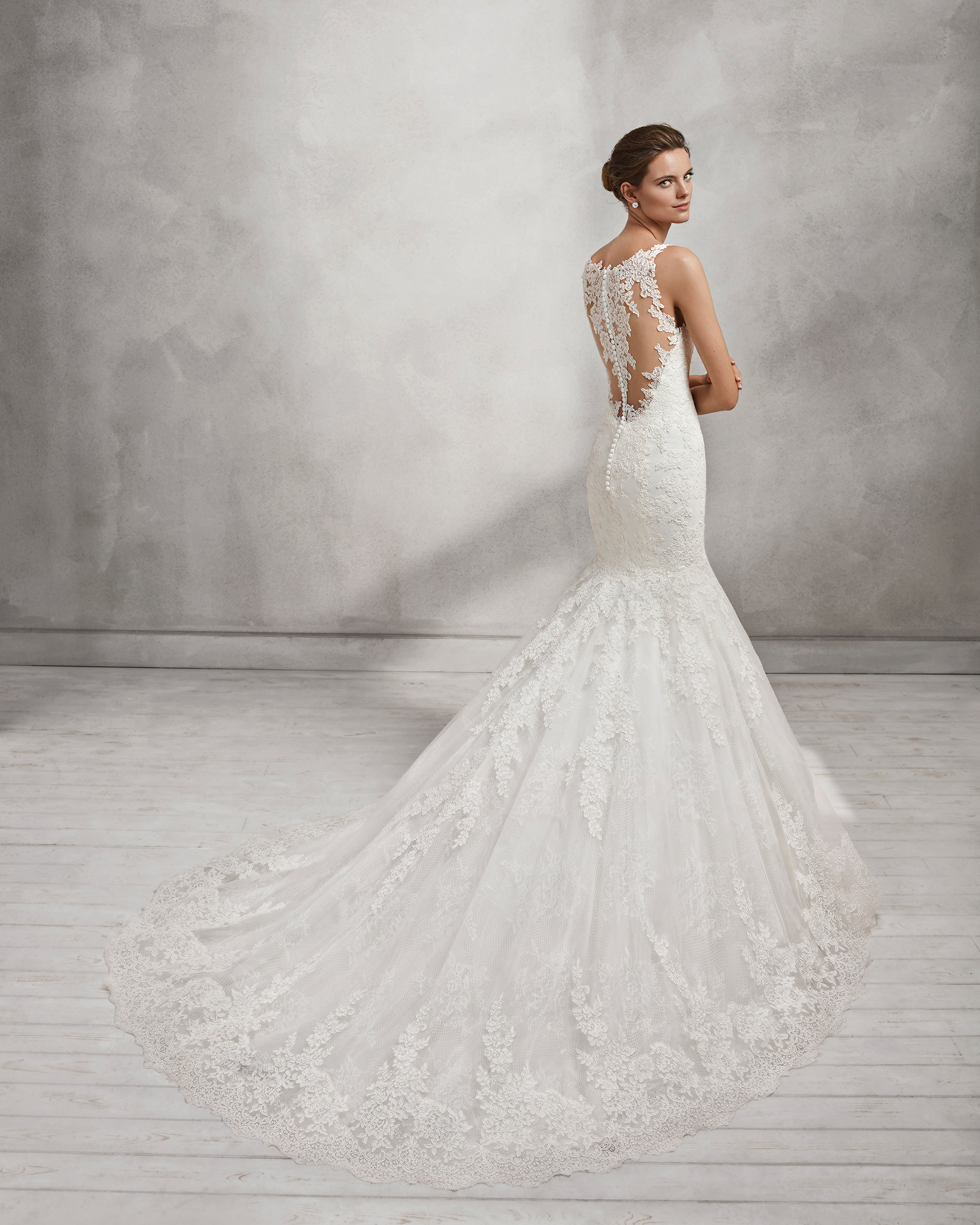 Mermaid-style lace wedding dress with tattoo-effect back.