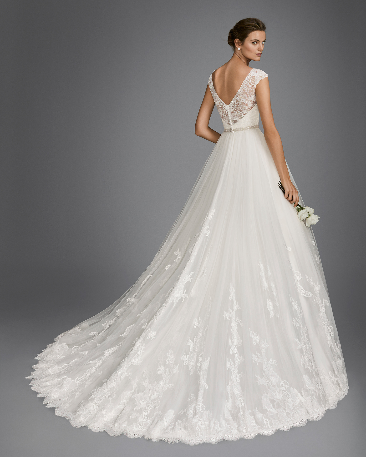 A-line beaded lace and tulle wedding dress with V-neckline and low back, in natural and white.