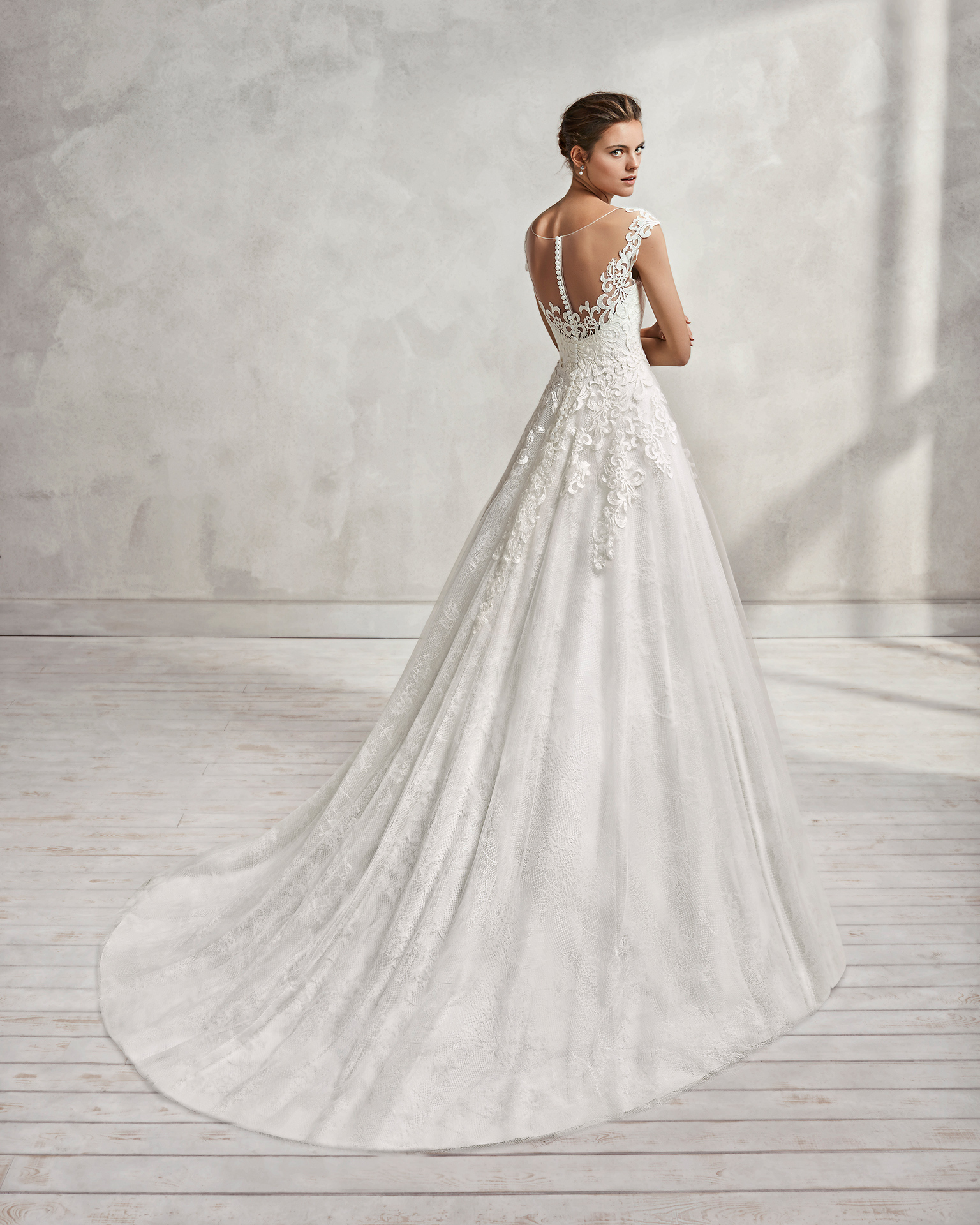 A-line lace and tulle wedding dress with sweetheart neckline and low back.