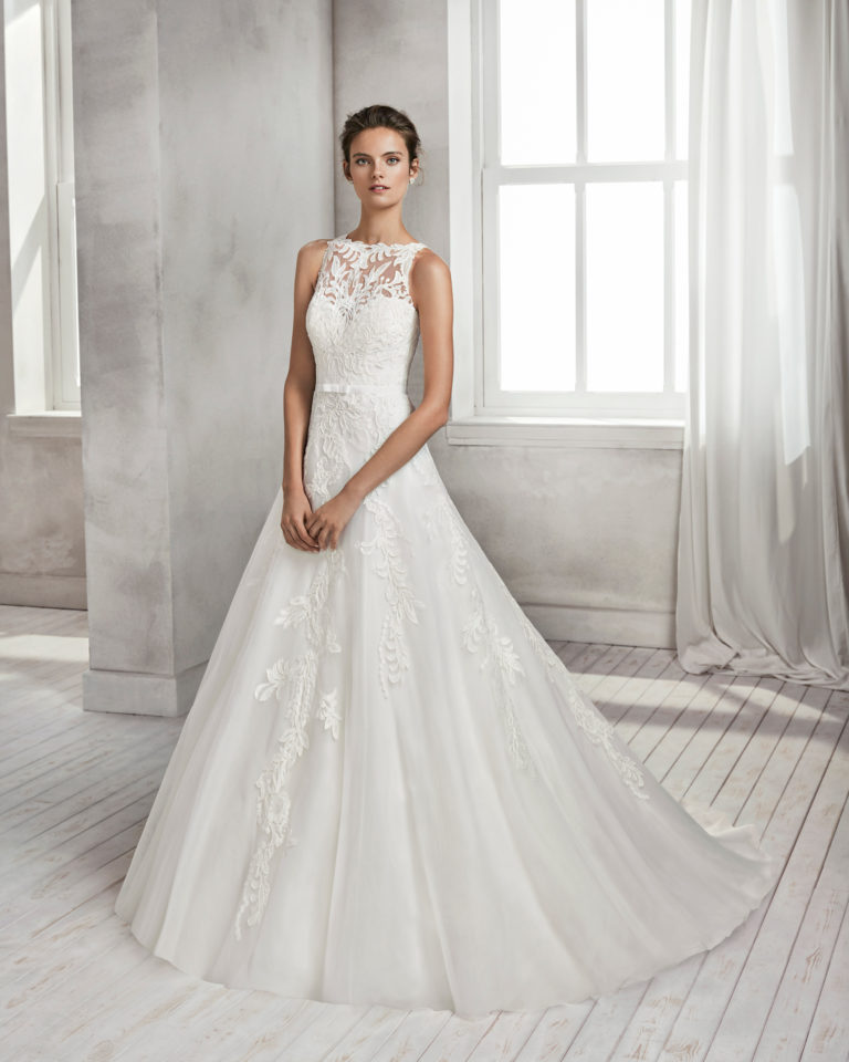 A-line beaded lace and tulle wedding dress with illusion neckline and low back.