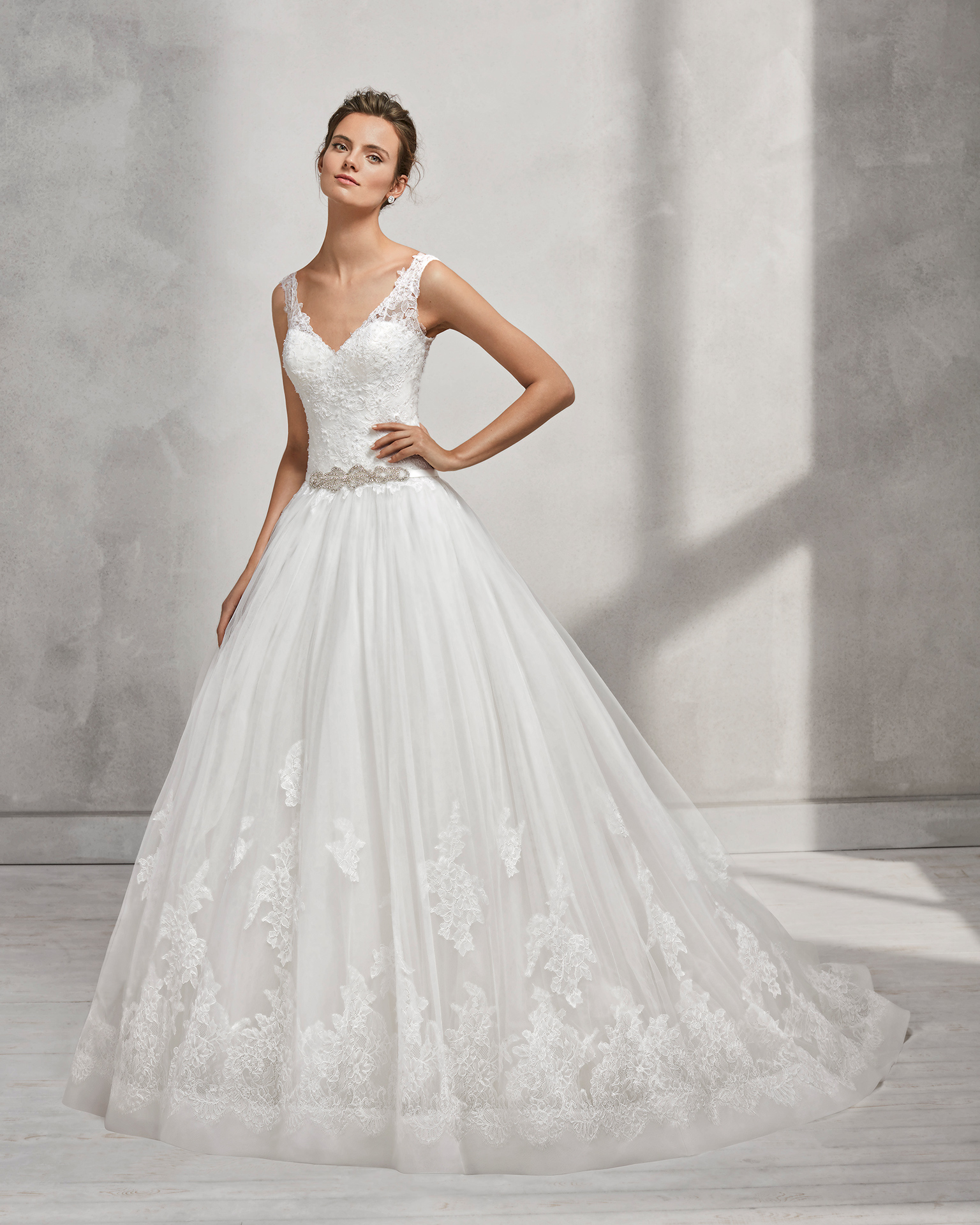 A-line beaded lace and tulle wedding dress with V-neckline and low back.