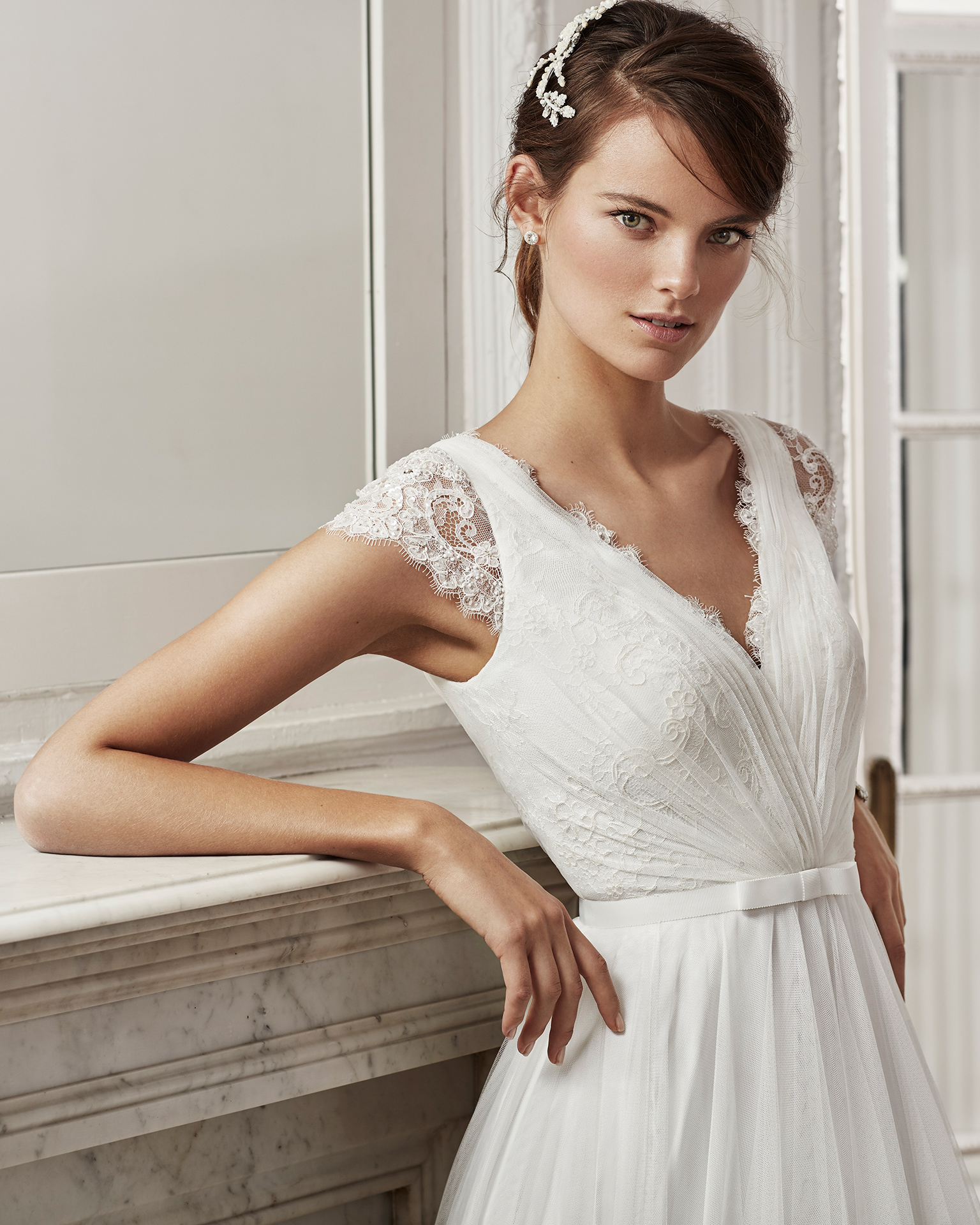 Beaded lace and tulle sheath wedding dress with short sleeves, V-neckline and low back.