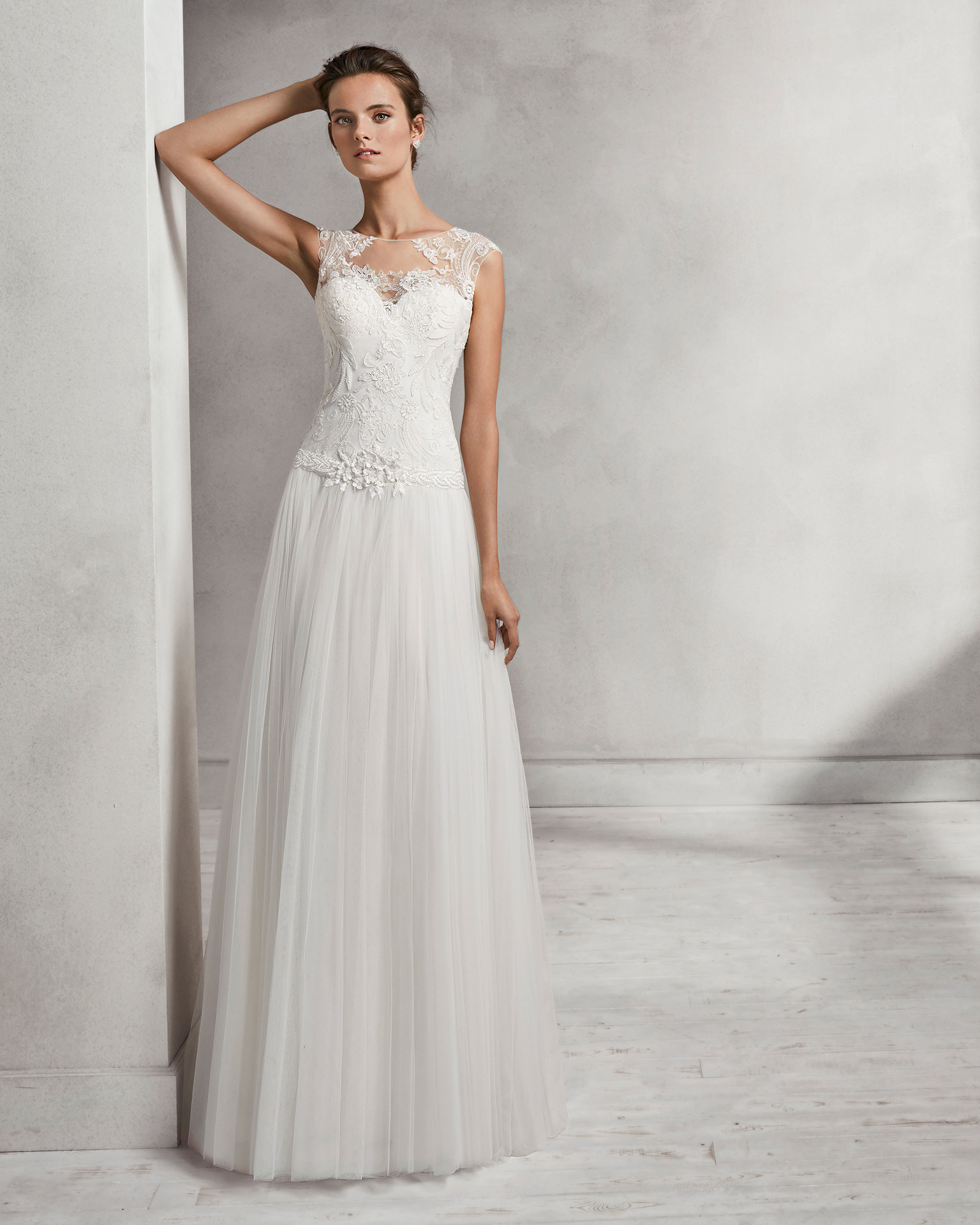 Beaded lace and tulle sheath wedding dress with illusion neckline.