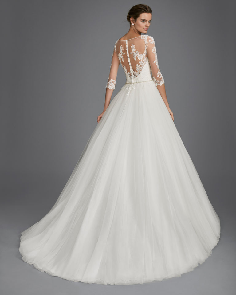 Princess style beaded lace and tulle wedding dress with three-quarter sleeves, V-neckline and low back.