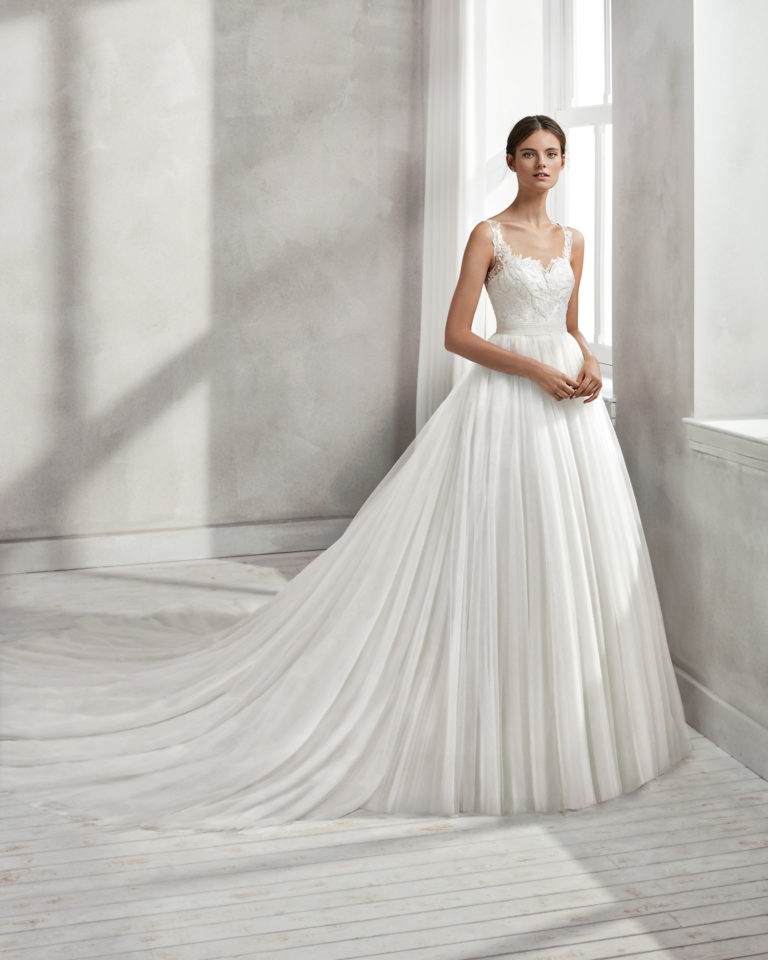 Princess-style beaded lace wedding dress with square neckline, low back and full tulle skirt.