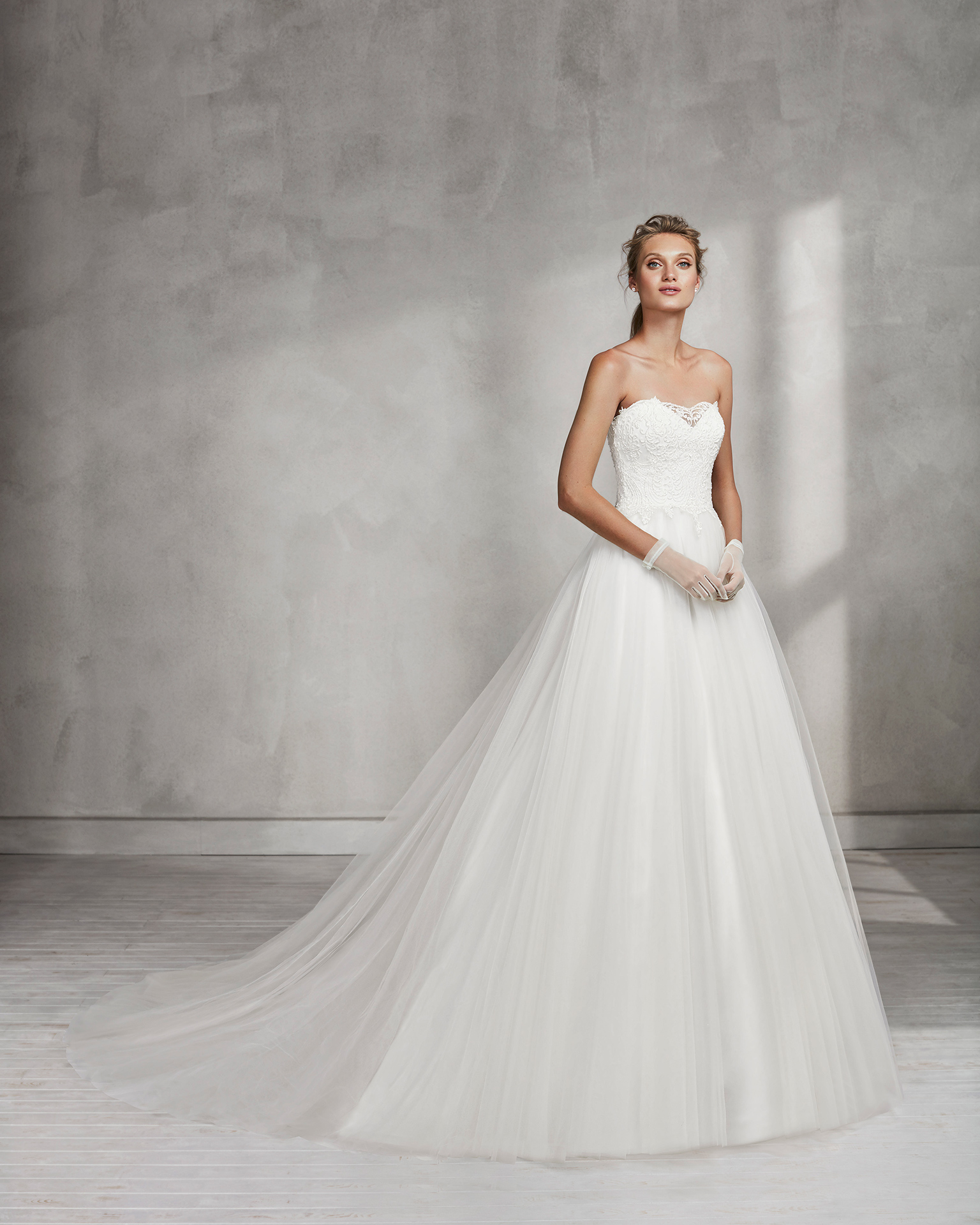 Princess-style beaded lace and tulle strapless wedding dress.