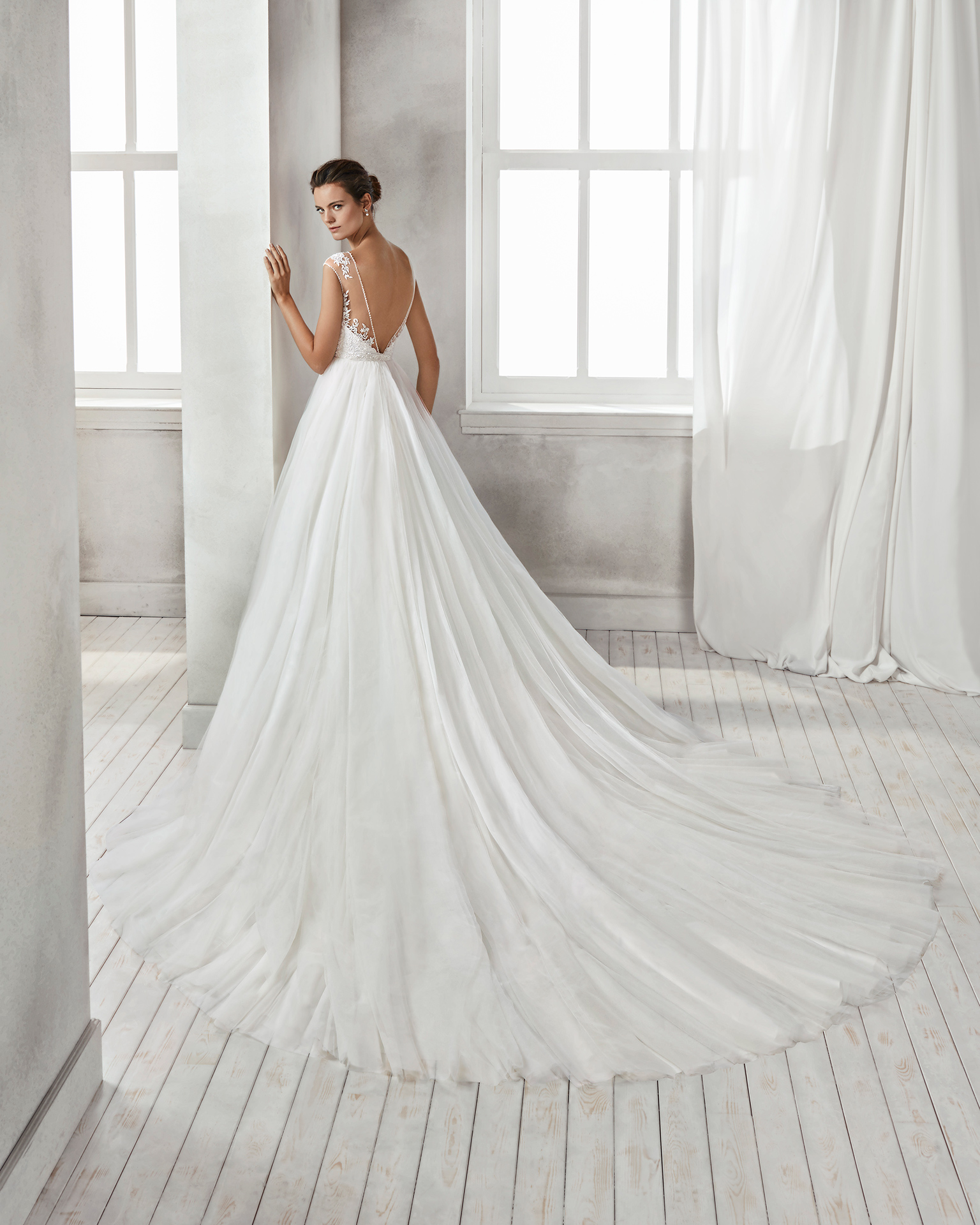 Princess-style beaded lace and tulle wedding dress with sweetheart neckline, low back and full tulle skirt.