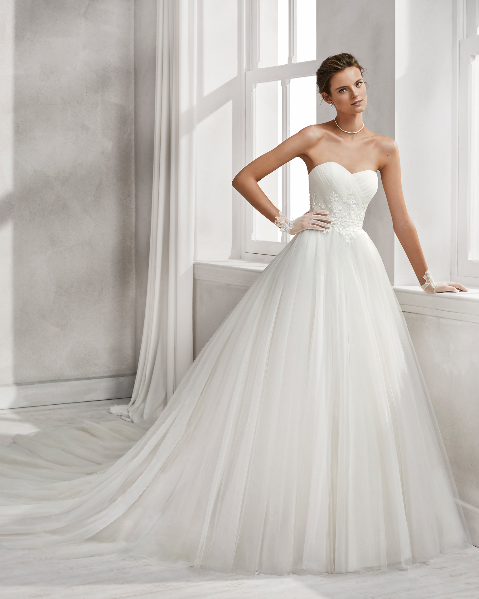 Princess-style beaded lace and tulle wedding dress with sweetheart neckline.