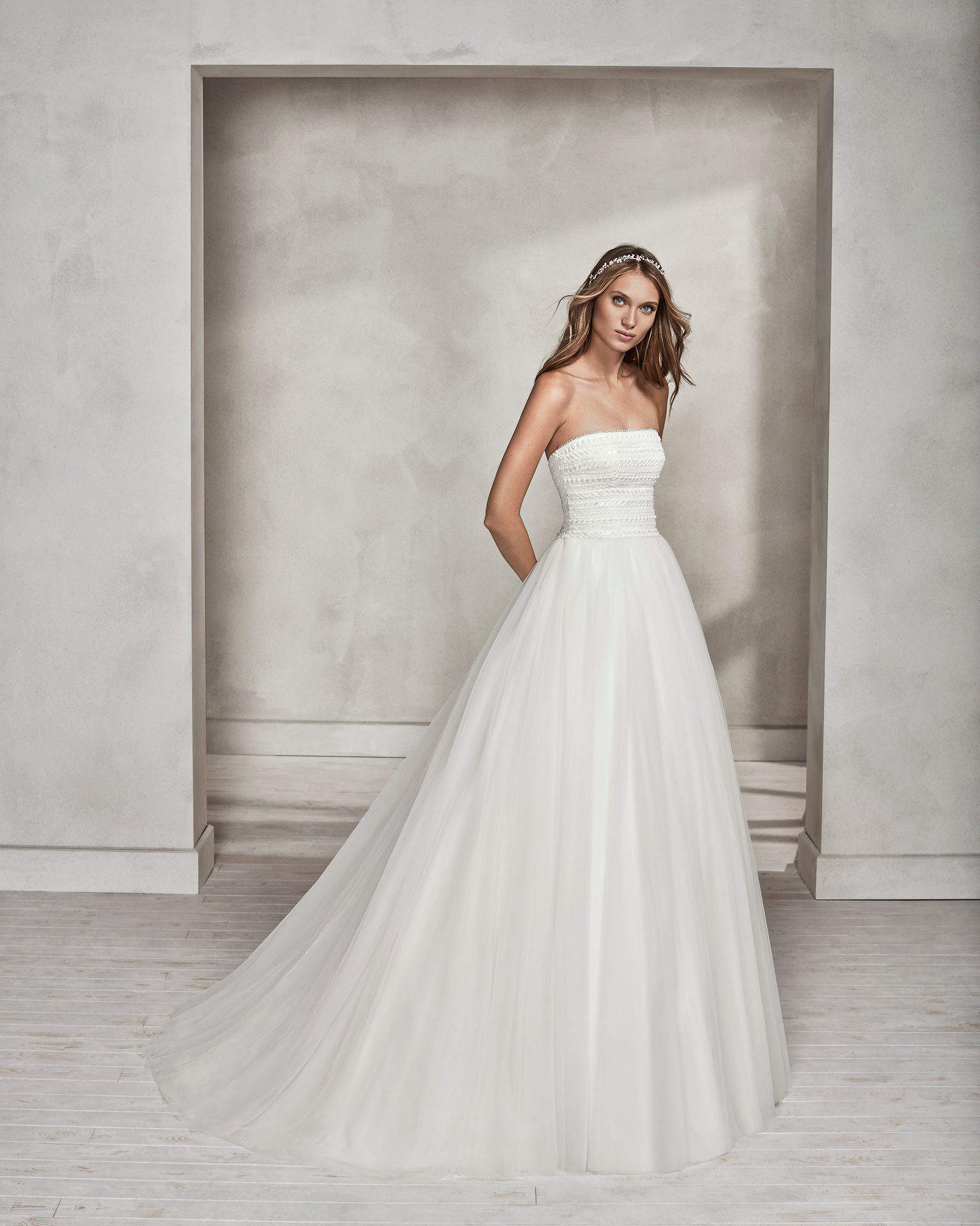 Princess-style beaded guipure lace and tulle strapless wedding dress.