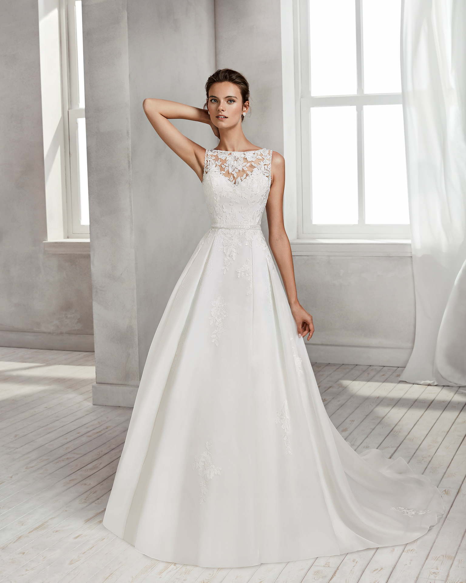 Princess-style beaded lace and organza wedding dress with illusion neckline and beaded lace back.