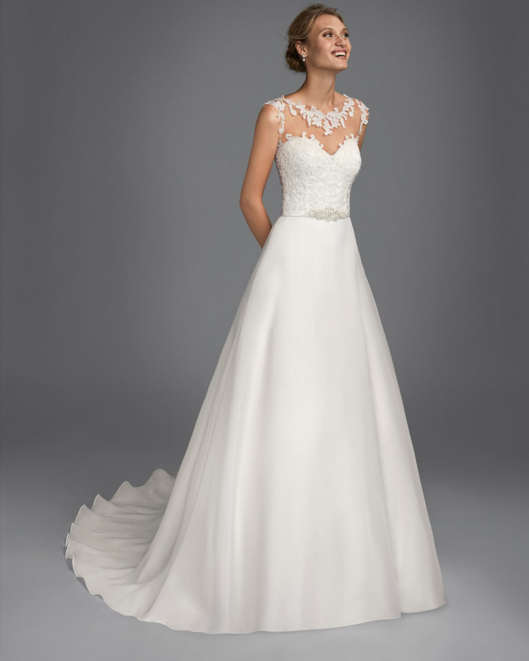 Princess-style beaded lace and organza wedding dress with illusion neckline and low back.