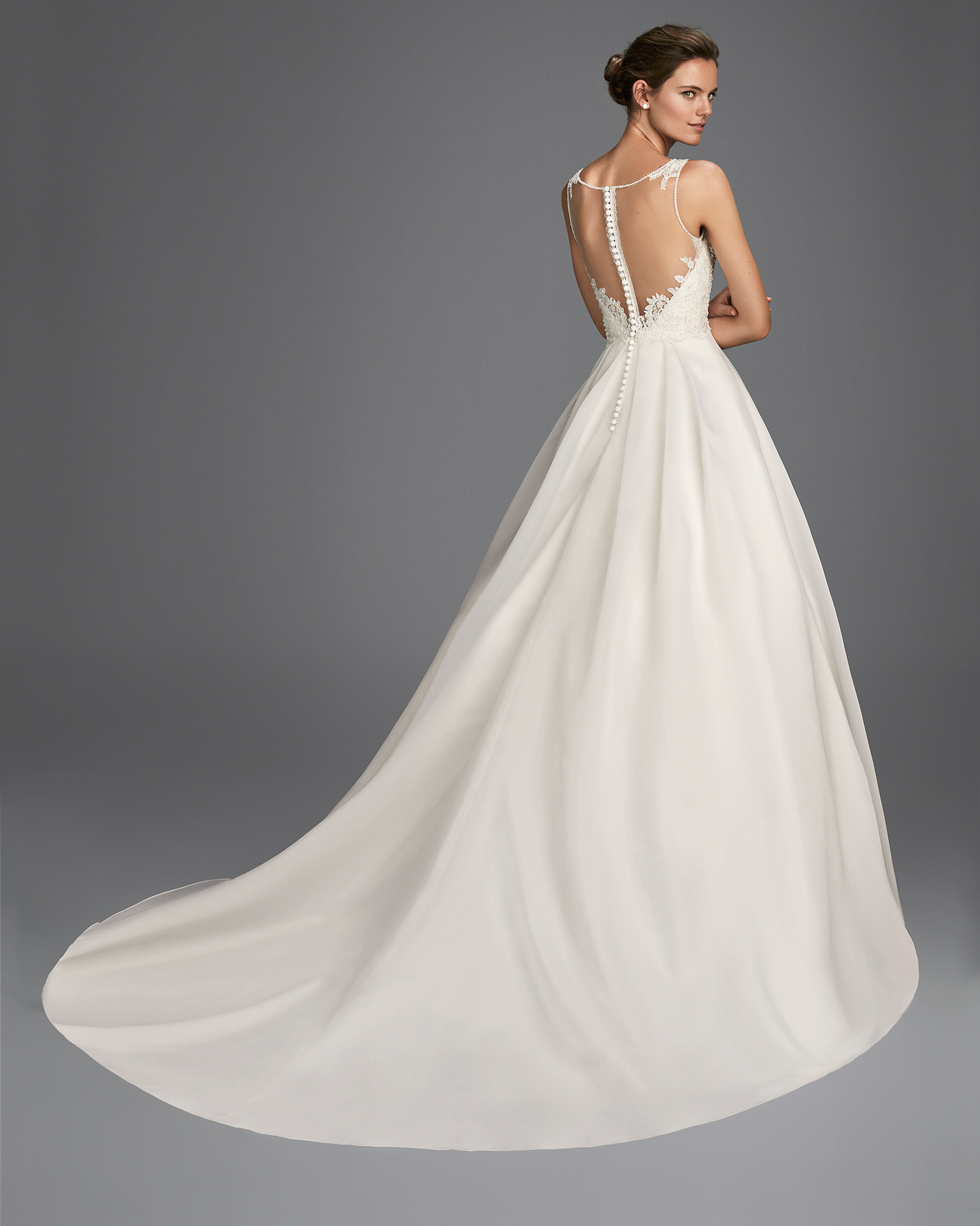 Princess-style beaded lace and organza wedding dress with V-neckline and low back.
