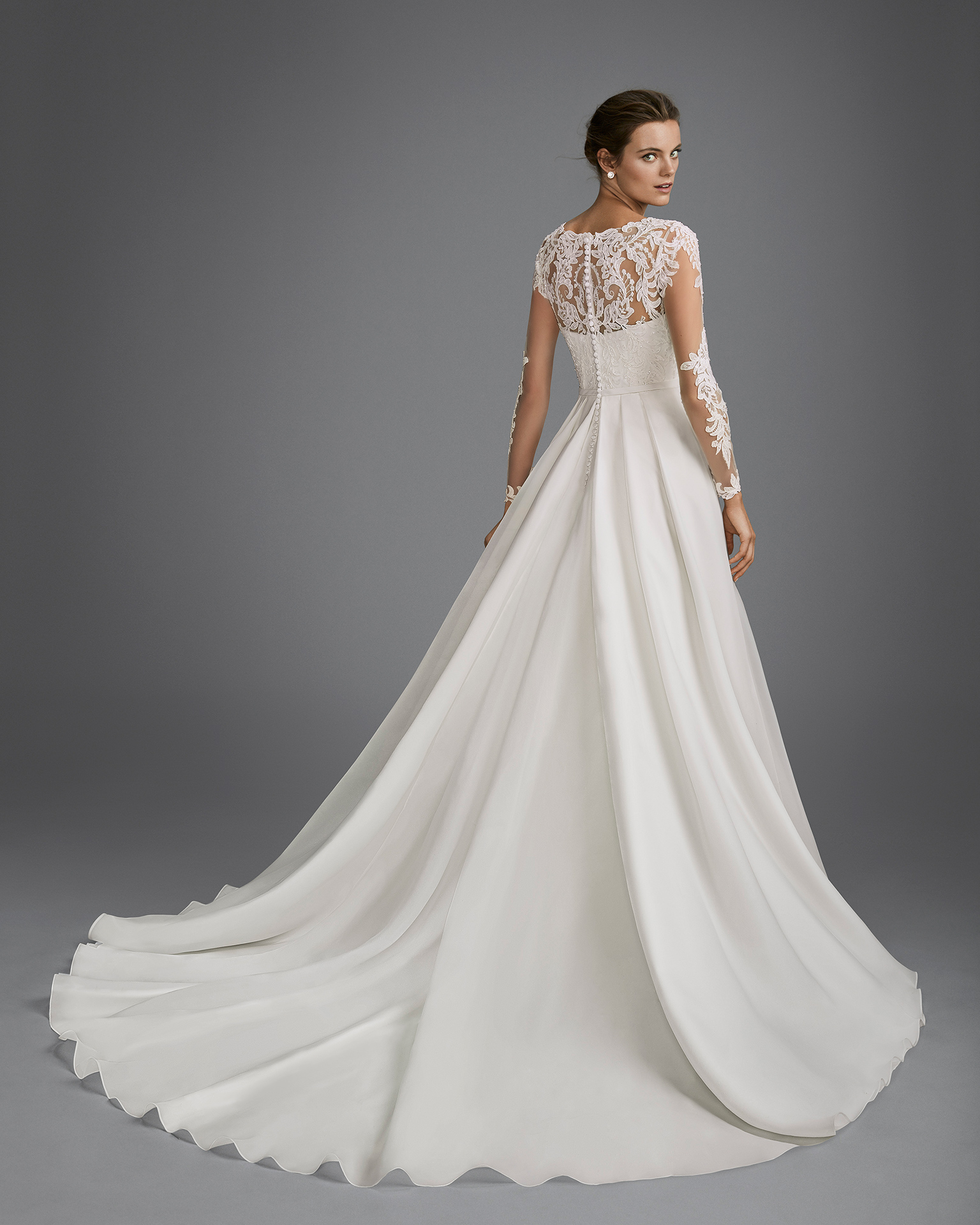 Princess style beaded lace and organza wedding dress with long sleeves and illusion neckline.