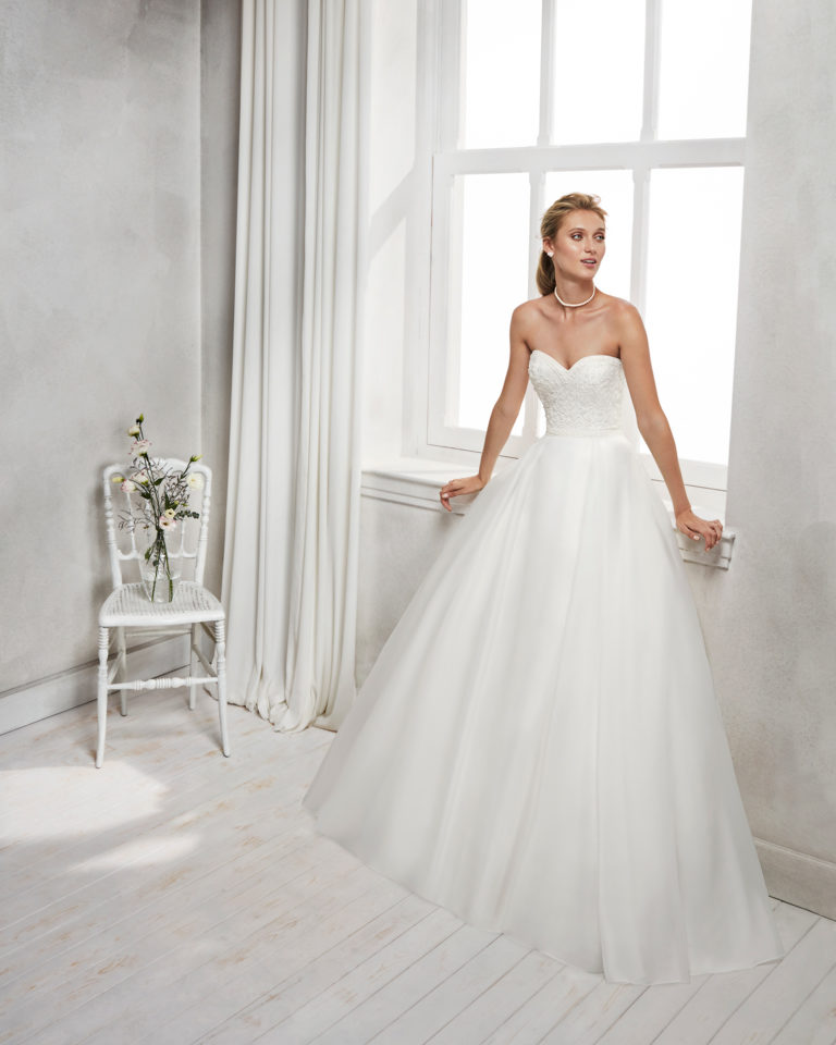 A-line beaded embroidered organza wedding dress with sweetheart neckline.