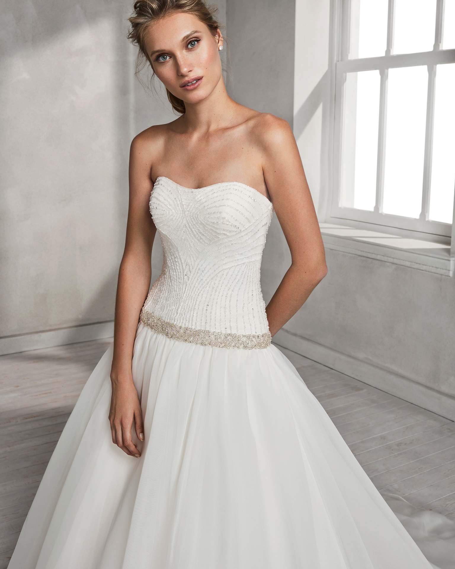 Princess-style beaded embroidered gazar wedding dress with sweetheart neckline and beaded belt.