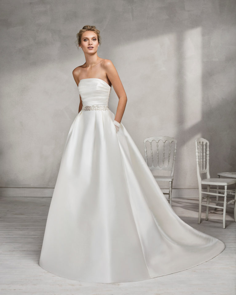 Classic-style mikado strapless wedding dress with beaded belt.