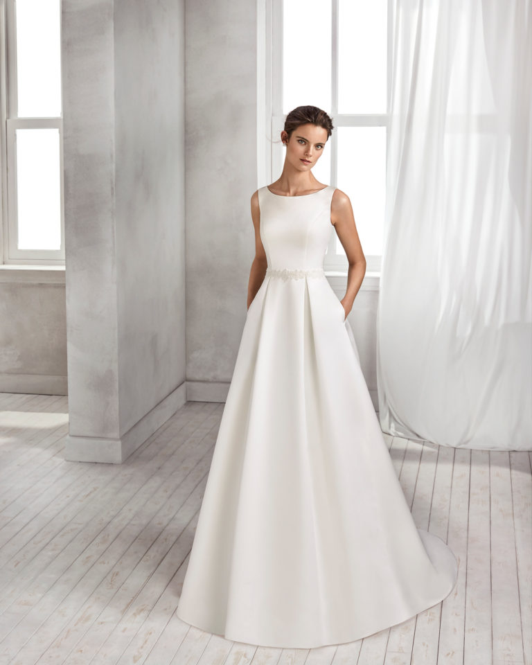 Classic-style satin wedding dress with bateau neckline and beaded belt.