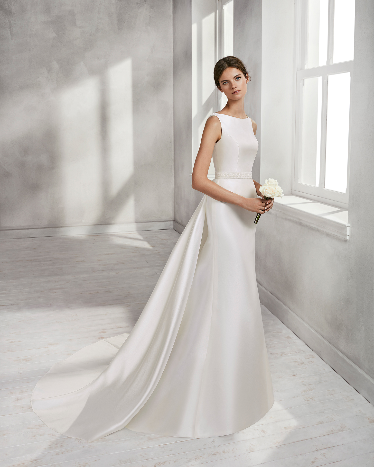 Mermaid-style mikado wedding dress with bateau neckline, beaded back and overskirt.