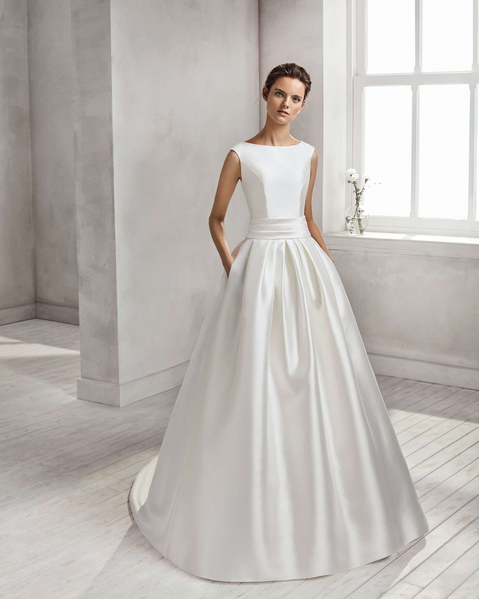 Classic-style mikado wedding dress with bateau neckline and open back with bow.