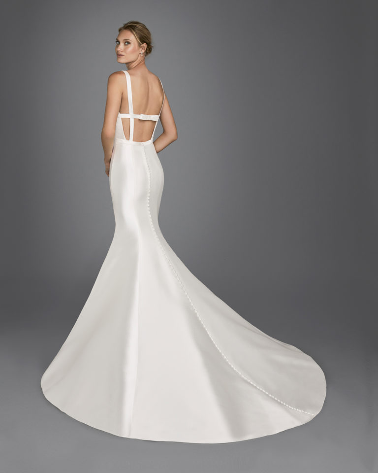Mermaid-style mikado wedding dress with bateau neckline, open back and bow at rear.