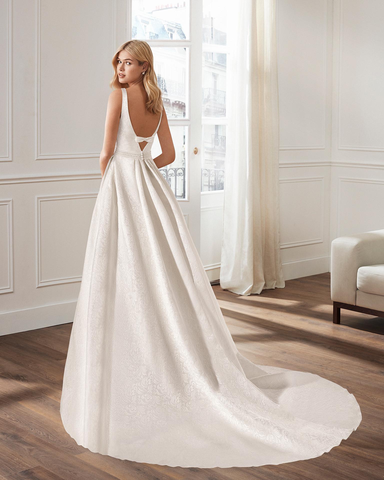 Beaded brocade wedding dress, in natural.