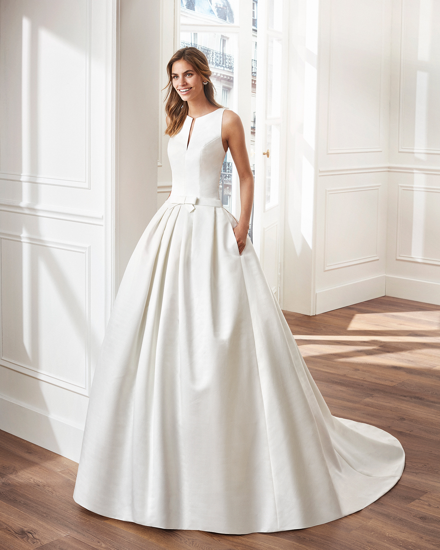 Classic A-line ottoman wedding dress. V-neckline and lace back. Available in natural. 2019  Collection.