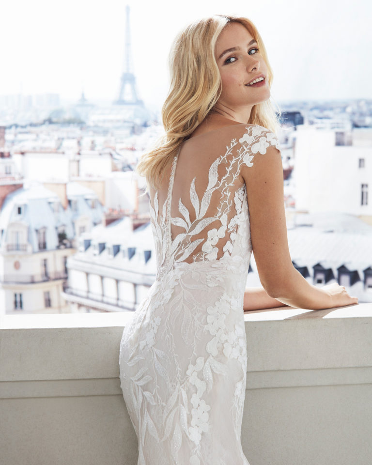 Mermaid-style lace wedding dress. Illusion neckline and appliquéd skirt. Available in natural and natural/nude. 2019  Collection.