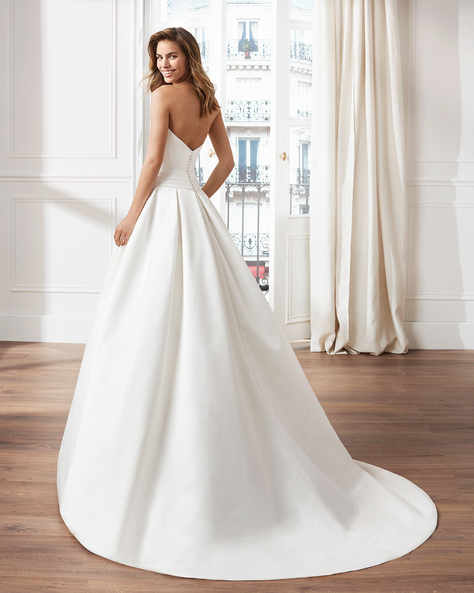 Classic A-line ottoman wedding dress. Strapless neckline and bow at the waist. Available in natural. 2019  Collection.