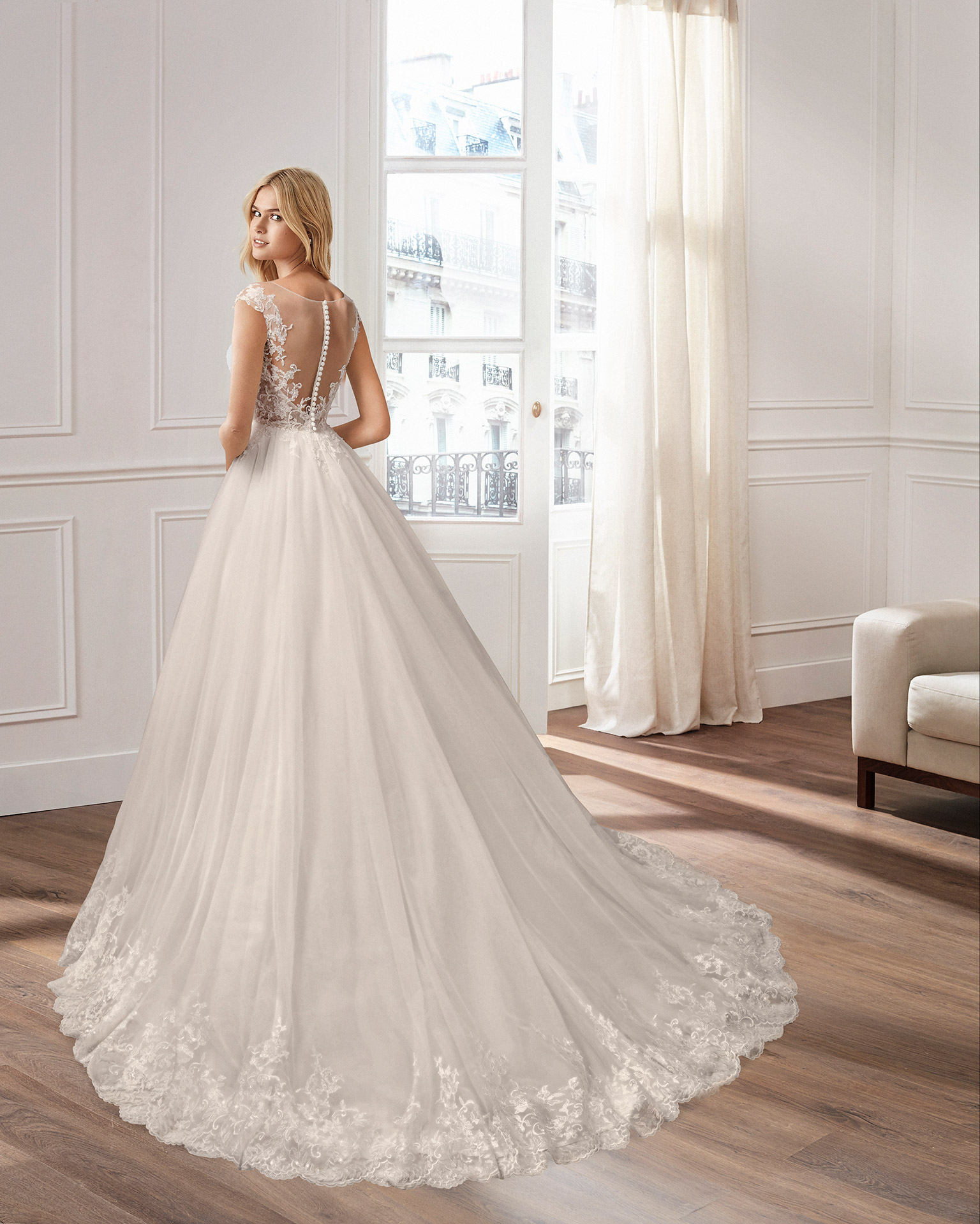 A-line beaded lace and tulle wedding dress with V-neckline and low back. 2020  Collection.