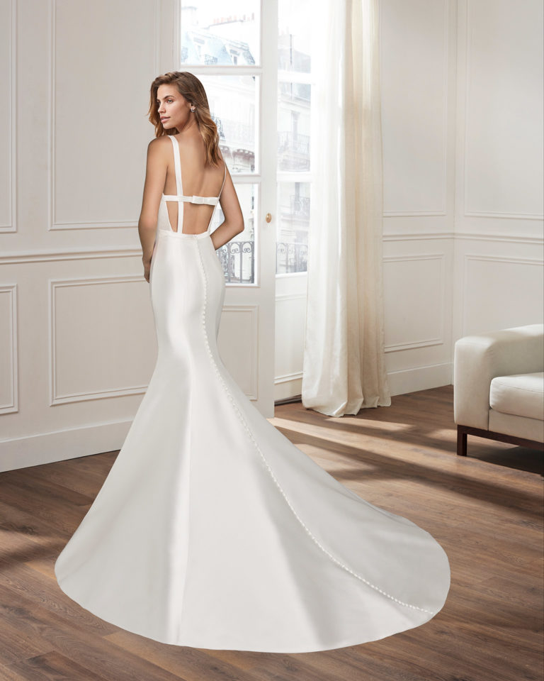 Mermaid-style mikado wedding dress with bateau neckline, open back and bow at rear. 2020  Collection.