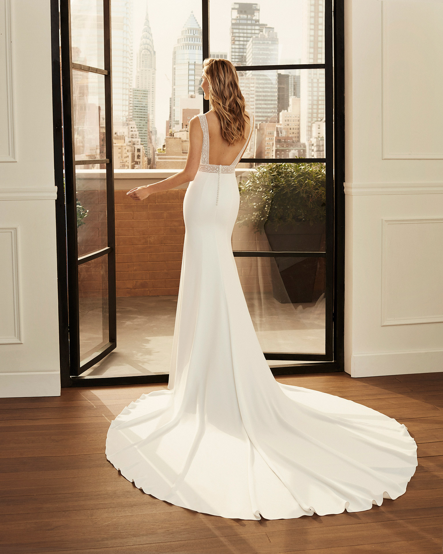 Mermaid-style lace and stretch crepe wedding dress with beading, bateau neckline, square back and lace detail at the waist. 2020  Collection.