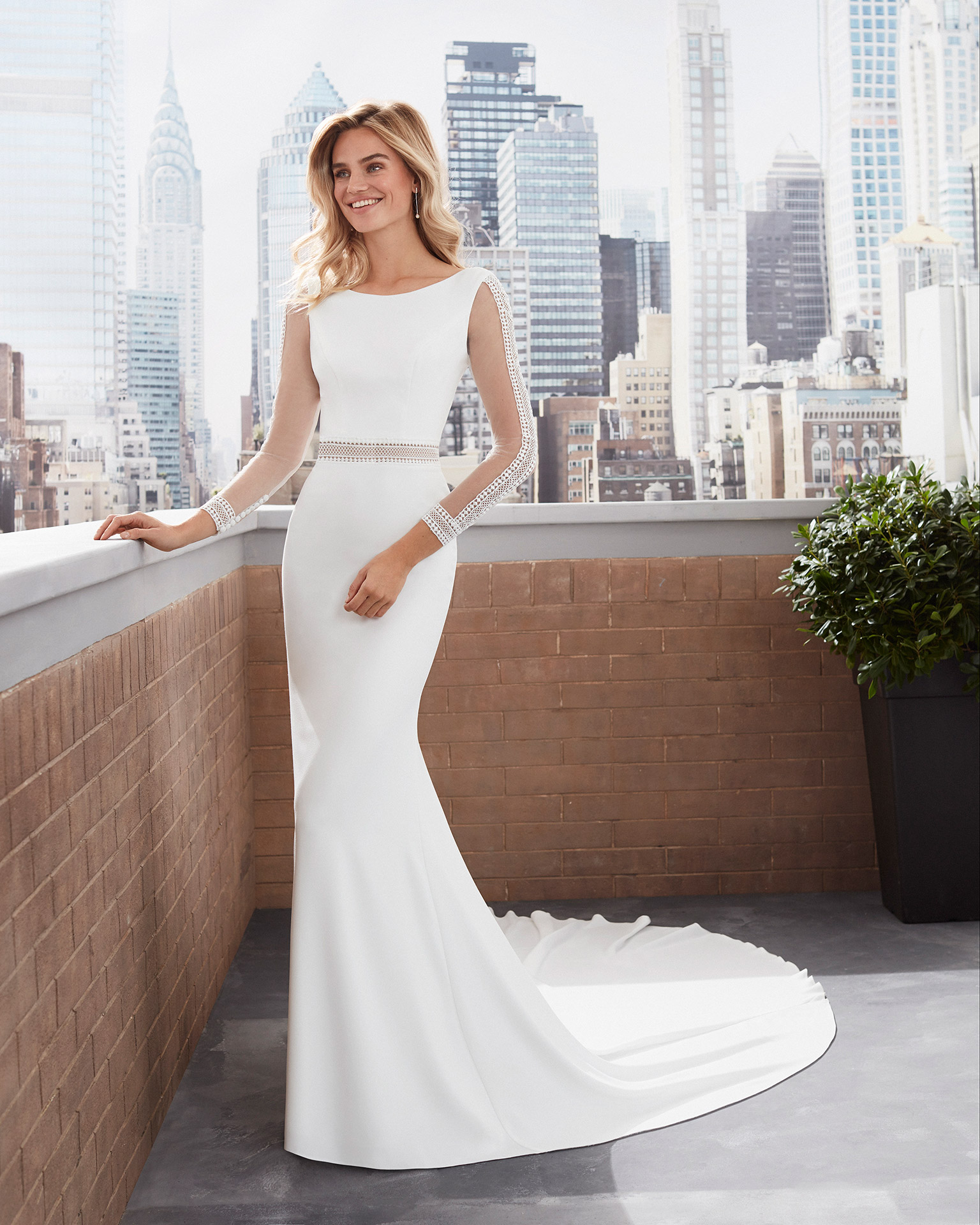 Mermaid-style lace and stretch crepe wedding dress, bateau neckline and square back with lace detail and long sleeves. 2020  Collection.