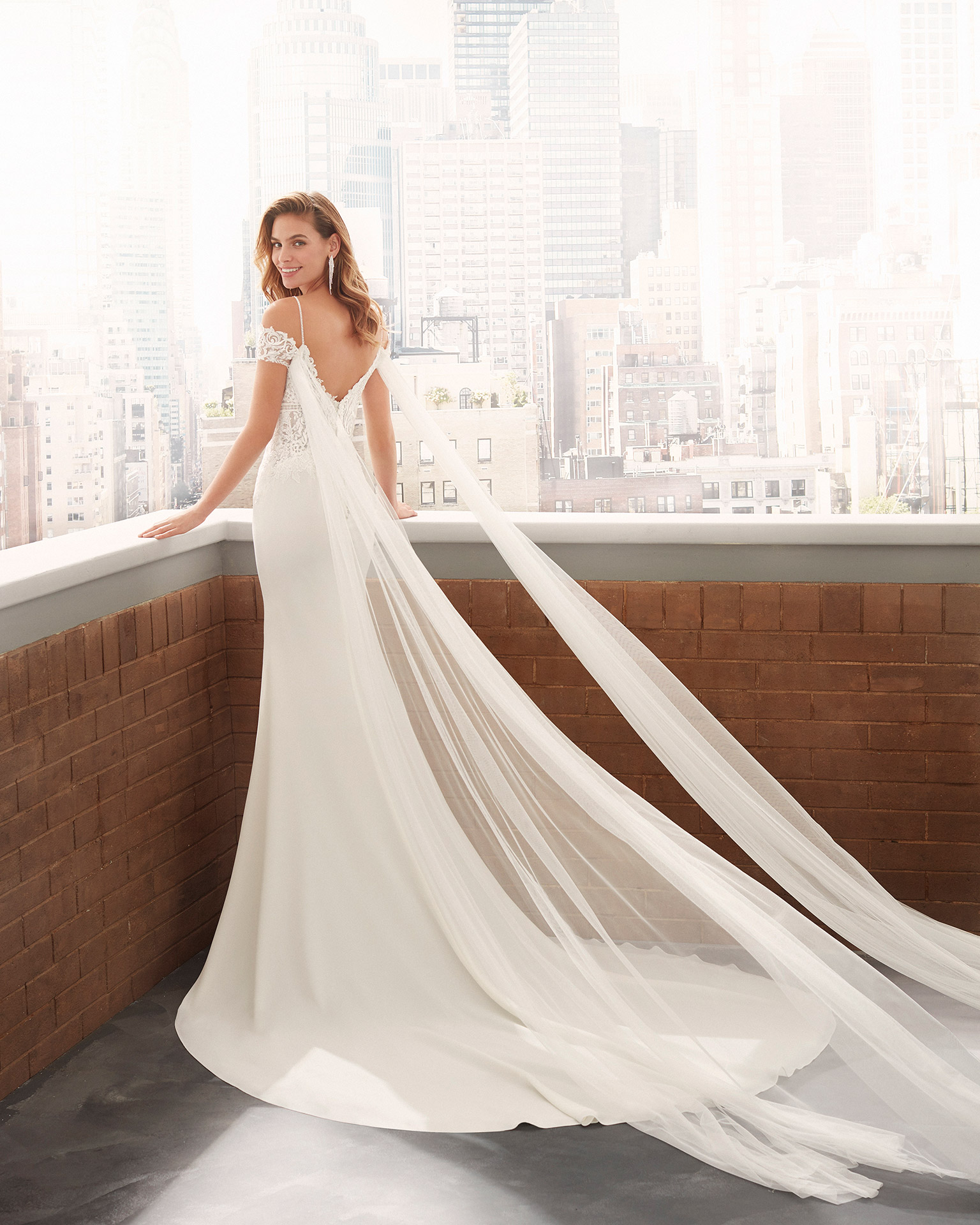 Mermaid-style wedding dress in crepe Georgette with beaded straps and deep-plunge neckline with draped tulle and V-back. 2020  Collection.