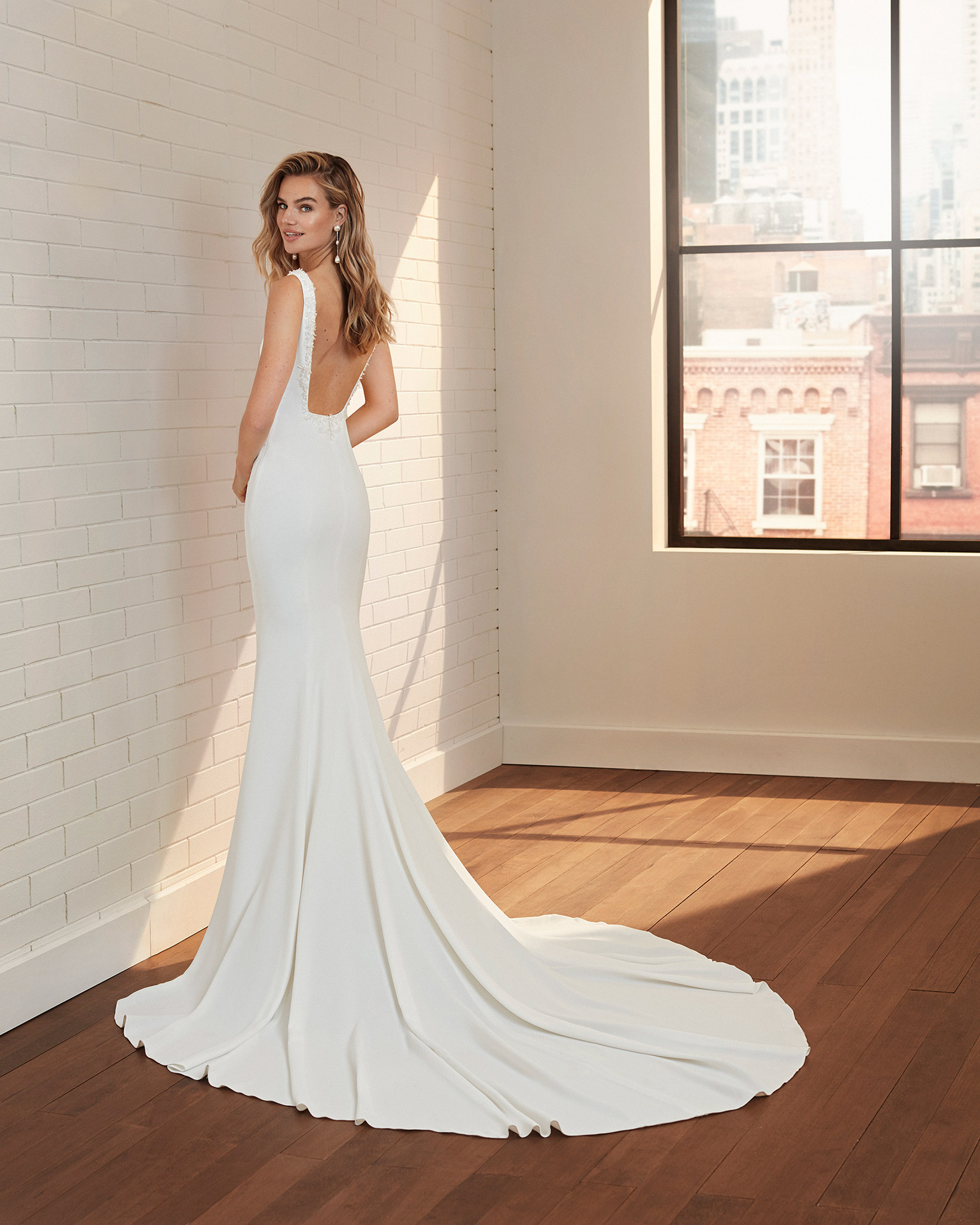 Mermaid-style wedding dress in stretch crepe with beading, bateau neckline and square back. 2020  Collection.